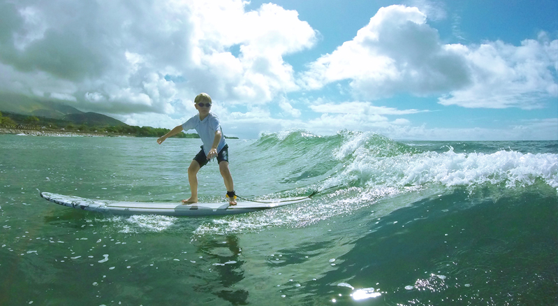 Boy surfing in Maui