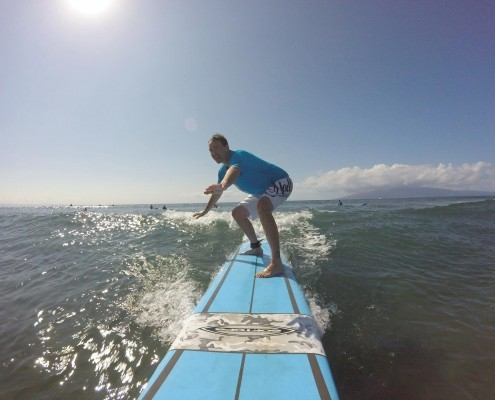 Man Riding Surf Board